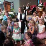 Reverend Katie Robb Davis with children at Wellshire Presbyterian Church